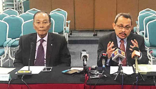 MACC Chief Commissioner Dzulkifli Ahmad (right) and MACC advisory board chairman Tunku Abdul Aziz Ibrahim speaking to reporters after a meeting.