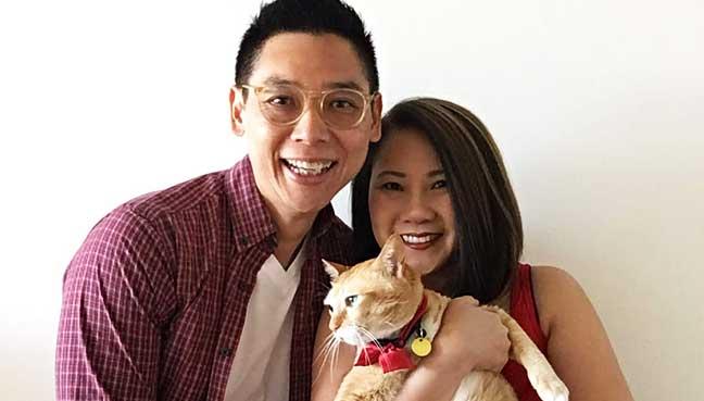 Melysa Soo-Hoo, husband Looi Miin Wei and cat, Friday in their Melbourne home.