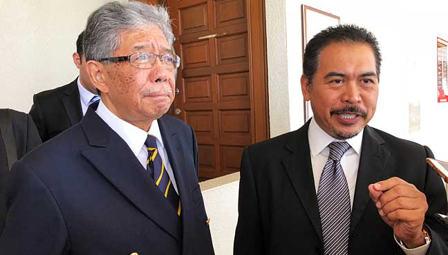 Tawfik Ismail (left) and lawyer Rosli Dahlan outside the High Court after the court's decision.