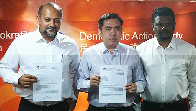 (From left) DAP deputy chairman Gobind Singh Deo, national organising secretary Anthony Lokeand Negeri Sembilan DAP assistant secretary Arul Kumar holding the RoS letter recognising the party's central executive committee line-up.