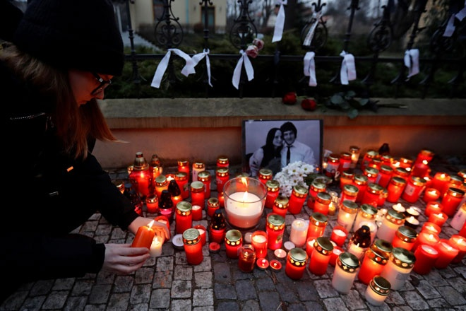 Thousands attend protest vigils for slain Slovak journalist