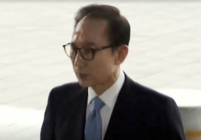 Ex-S.Korean president questioned over corruption charges