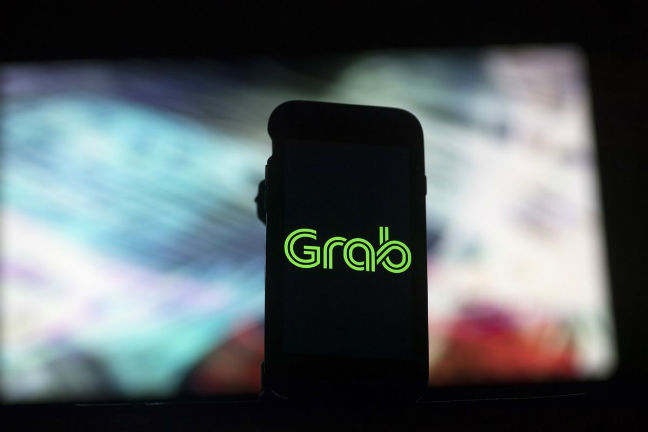 Southeast Asia's Grab buys Uber's regional business