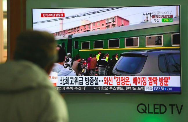 Kim Jong Un visits China on 'armoured' train
