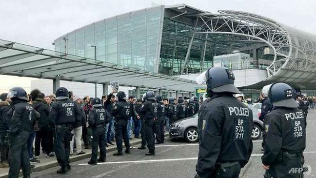 KURDISH PROTESTORS AIRPORT GERMANY UK STATIONS AFP PIC