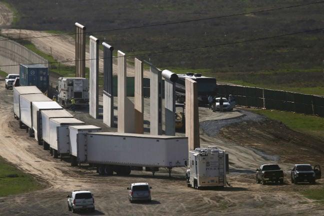 PROTOTYPE TRUMP WALL BLOCKED BY TRUCKS MEXICO BORDER REUTERS