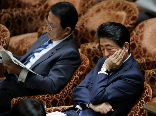 SHINZO ABE TARO ASO JAPAN PARLIAMENT SCANDAL REUTERS