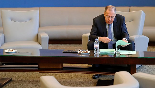 Lavrov, Minister for Foreign Affairs of Russia reads documents before briefing the media at the United Nations. (Reuters pic)