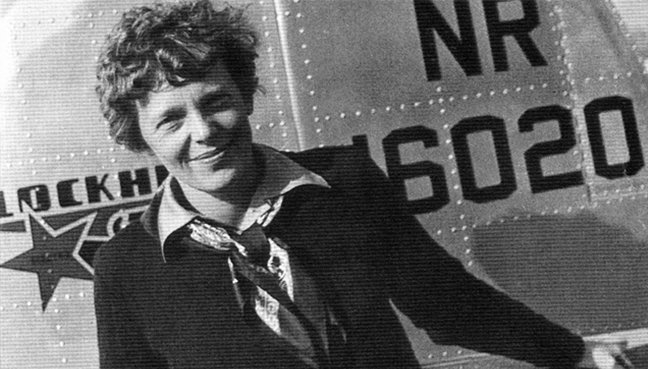 Famed aviatrix Amelia Earhart pictured with her Lockheed Electra10E before her ill fated quest to fly around the world in this undated photograph. (Reuters pic)