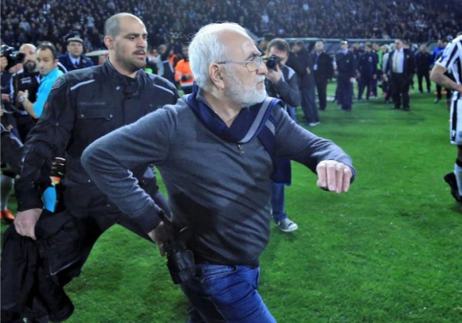 Top Greek football match abandoned as armed owner confronts referee