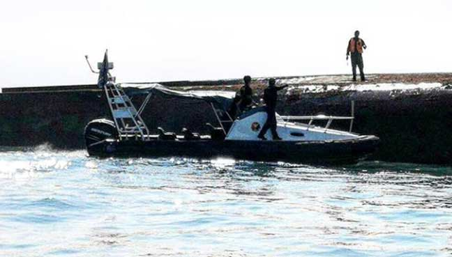 Capsized vessel may have crew trapped inside