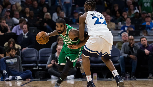 Boston Celtics guard Kyrie Irving (11) dribbles against Minnesota Timberwolves guard Andrew Wiggins (22) in the fourth quarter at Target Center. (Reuters/USA Today pic)