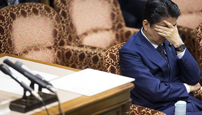 Majority believe Japan PM bears some responsibility for altered documents