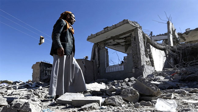 Yemenis check the damage in the aftermath of a reported air strike by the Saudi-led coalition in Sanaa on 8 March (AFP pic)