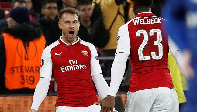 Arsenal's Aaron Ramsey celebrates with Danny Welbeck after scoring their second goal