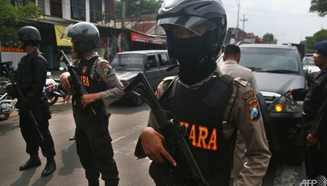Attack on police headquarters leaves an officer, 4 attackers dead in Indonesia
