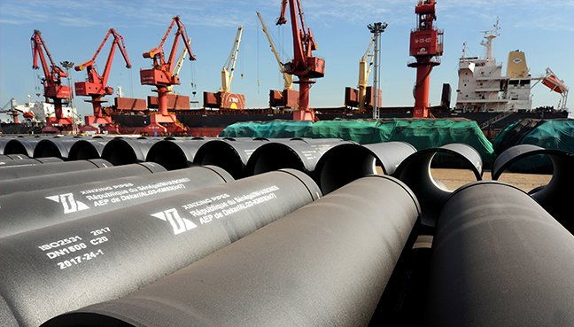 Steel pipes to be exported are seen at a port in Lianyungang Jiangsu province