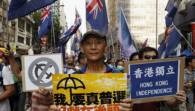 Police stop protest at Hong Kong handover anniversary event