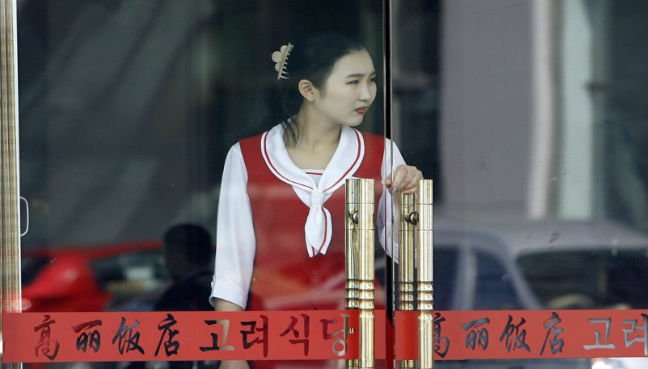 North Korean waitress at a restaurant in Dandong – not one of the women who defected