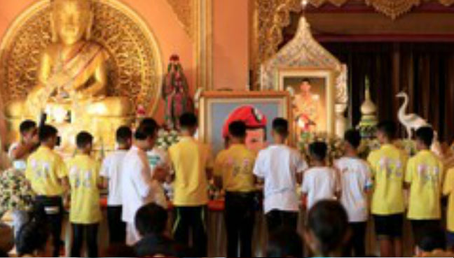 Candles and chanting: Thai cave boys on the way to Buddhist novices