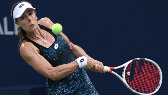 Alize Cornet penalised for briefly removing shirt during US Open heatwave