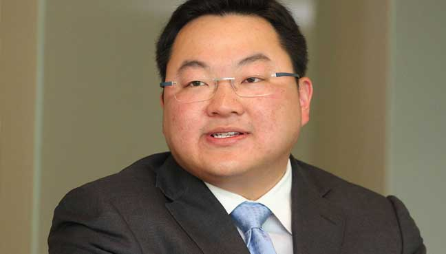 Malaysia files criminal charges against Jho Low and father