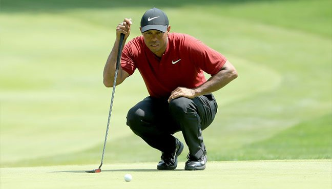Tiger Woods lines up a putt on the sixth green during the World Golf Championships Bridgestone Invitational – Final Round