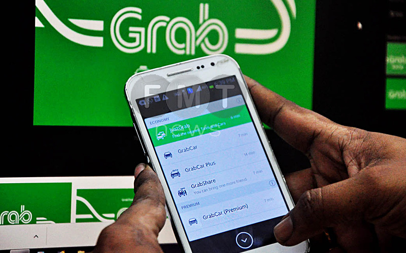 Singapore fines Grab, Uber RM39 million for merger