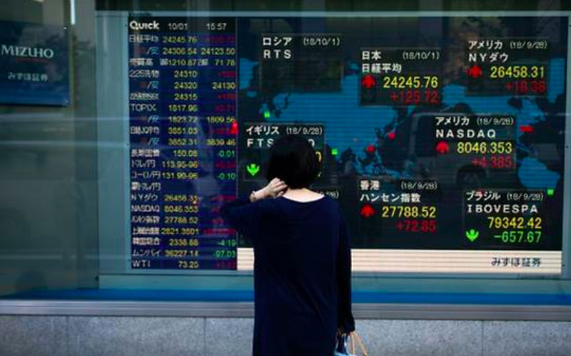 Asia stocks wobble as trade fears overshadow Huawei reprieve