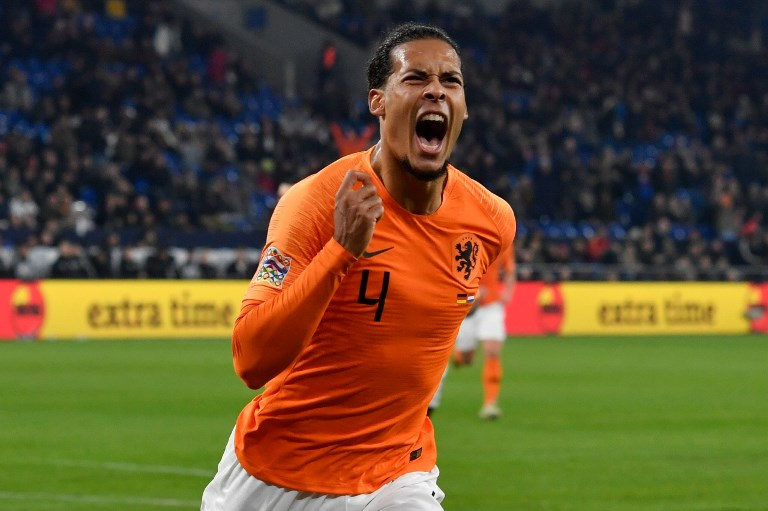 Netherlands' defender Virgil van Dijk celebrates during the UEFA Nations League match against Germany in Gelsenkirchen