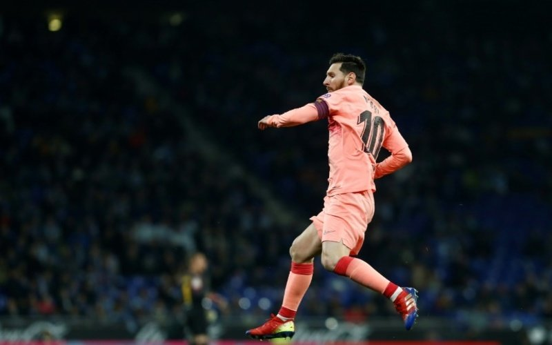 Lionel Messi scored two free-kicks and set up another goal as Barcelona romped past local rivals Espanyol 4-0