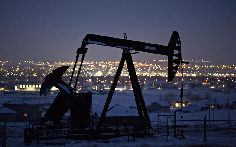 Oil settles 1% higher on hopes of market rebalance, trade deal
