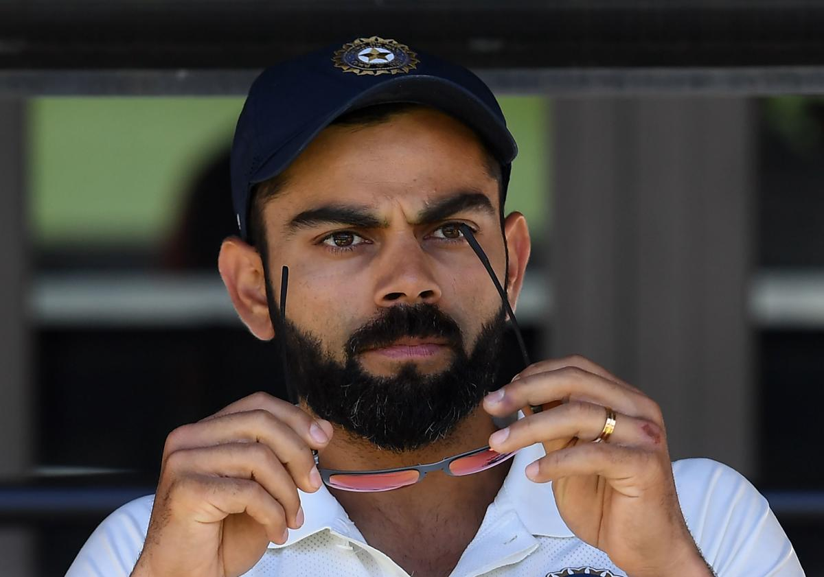 India captain Virat Kohli sits on the players bench at the end of 2nd Test match against Australia in Perth