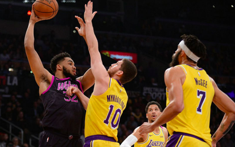 98c7d1ab00c Minnesota Timberwolves centre Karl-Anthony Towns (32) controls the ball  against Los Angeles Lakers guard Sviatoslav Mykhailiuk (10) and centre  JaVale McGee ...