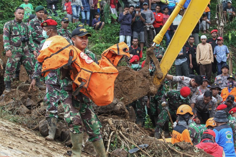 Rain sets off Indonesia landslide, killing 9 with 34 missing