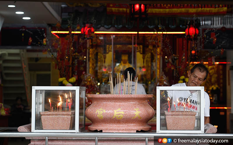 On Chinese New Year, people burn incense and pray for good luck.