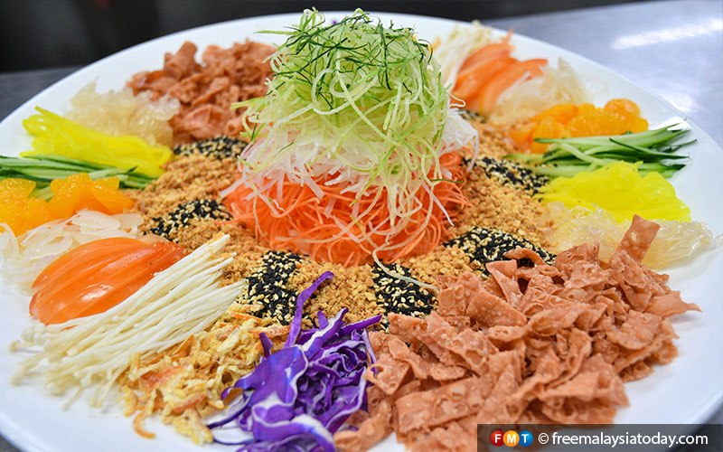 """Yee sang, a ritual where a mixture of ingredients is tossed high in the air with a shout of """"Loh Hey"""", which literally means to """"move upwards""""."""
