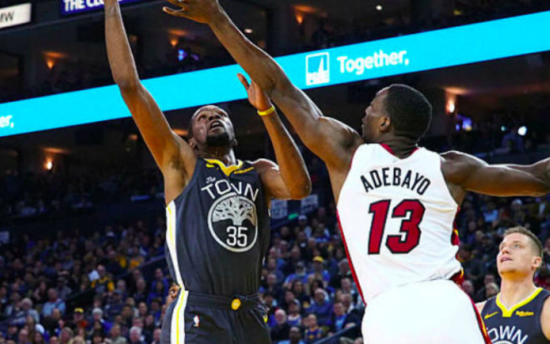 9761f275e Golden State Warriors forward Kevin Durant (35) shoots the ball against  Miami Heat centre Bam Adebayo (13) during the third quarter at Oracle Arena.