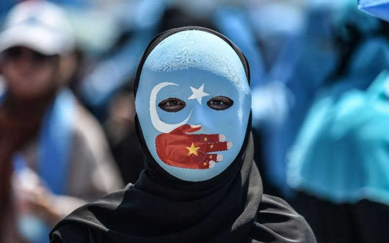 China refutes reports of Uighur artist's death