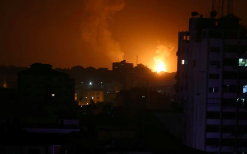 Smoke and flames are seen during an Israeli air attack on Gaza on Friday