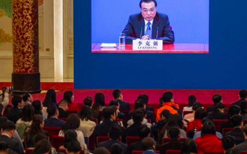 China does not ask firms to spy on others, says Premier Li