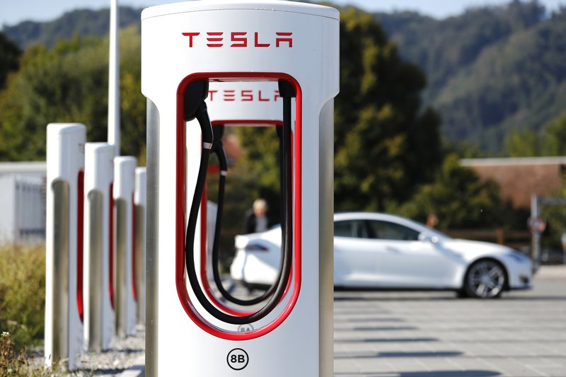 A Tesla Inc Model S electric vehicle charges at a Supercharger station in Rubigen Switzerland on Aug. 16 2018