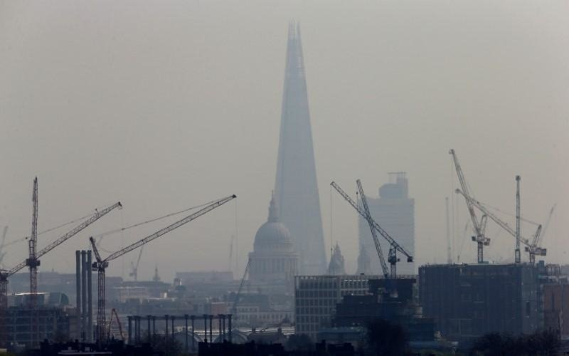 Smog surrounds The Shard and St Paul's Cathedral in London Britain