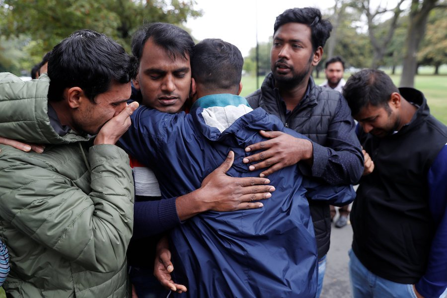 Relatives of a victim of the mosque shootings wait for news at a community centre in Christchurch New Zealand