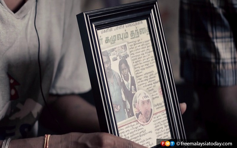 10.-The-family-keeps-a-picture-of-Adi-Kamal-in-a-newspaper-clipping-in-their-home.