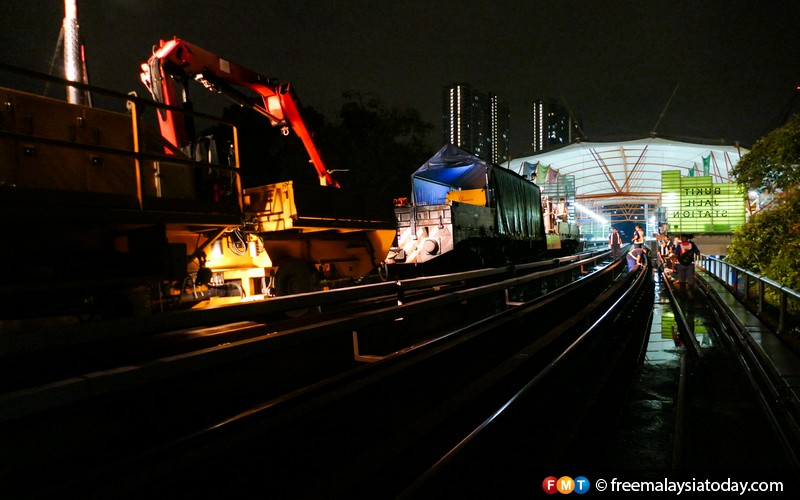 The Ampang Line crew at work on the tracks at the Bukit Jalil station.