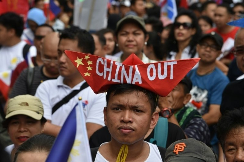 Manila protesters descend on Chinese embassy, warn of 'invasion' of Philippines