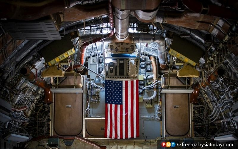 An American flag hangs in the cargo bay of the military transport aircraft C-17, among those on display at LIMA'19.