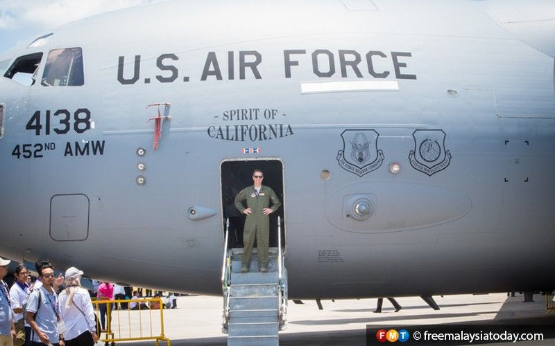 US Air Force pilot Captain Jeremy Shields poses with a C-17 transport aircraft.
