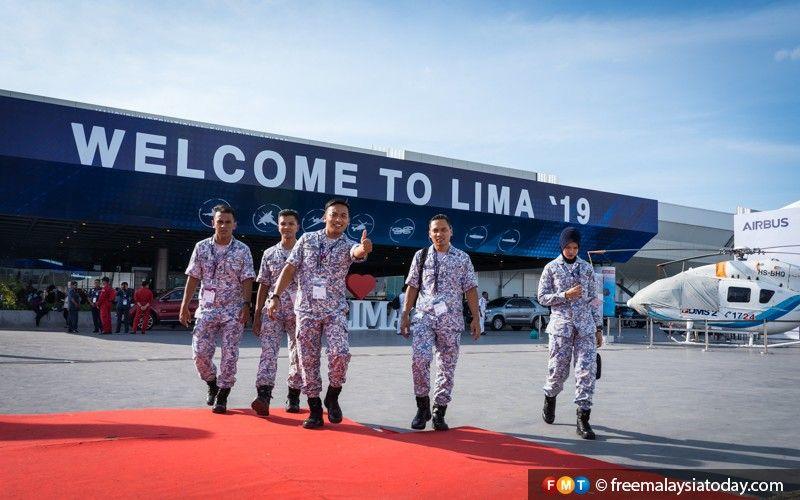 A Royal Malaysian Navy member gives the thumbs-up at LIMA'19.